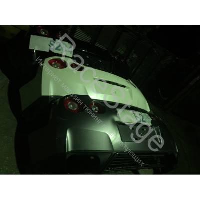Задний  бампер в сборе с фонарями NISSAN GTR R35 (2014-2017)